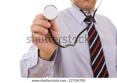 stethoscope in the doctor hand pointing to you (selective focus)