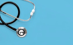 Stethoscope isolated on blue background. The stethoscope is a medical instrument for listening to the action of someone's heart or breathing. with copy space for your text.