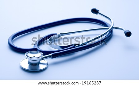 stethoscope isolated on page of notebook