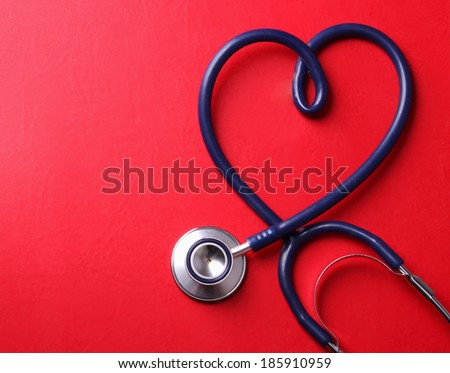 Stethoscope isolated on red background