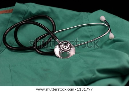 Stethoscope laying on nurses smock