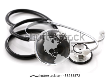 Stethoscope next to glass globe world map concept for global medical solutions - stock photo