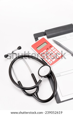 Stethoscope of medical equipment, and medical records, Calculator.