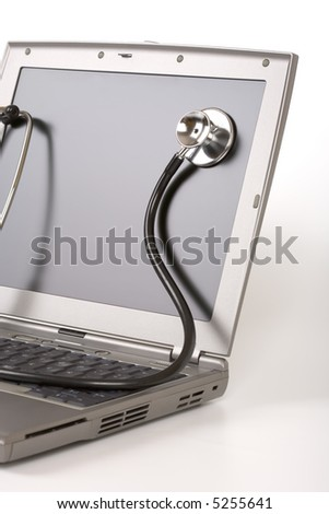 Stethoscope on a laptop screen - Computer tech concept