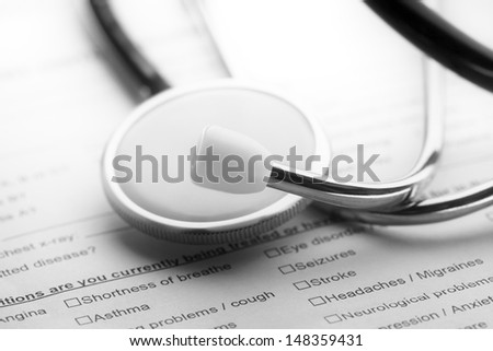 Stethoscope on a medical form. Healthcare concept.