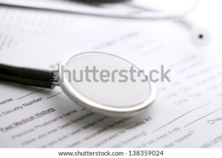 Stethoscope on a medical form. Medical concept.