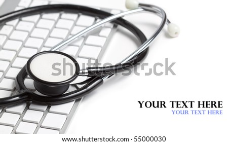Stethoscope on a modern keyboard isolated on white with space for text