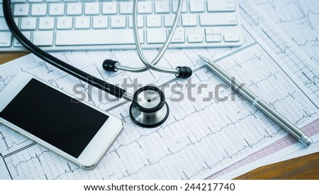 Stethoscope on cardiogram concept for heart care on the desk