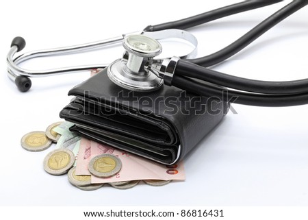 stethoscope on currency cash and wallet for financial examination healthy concept