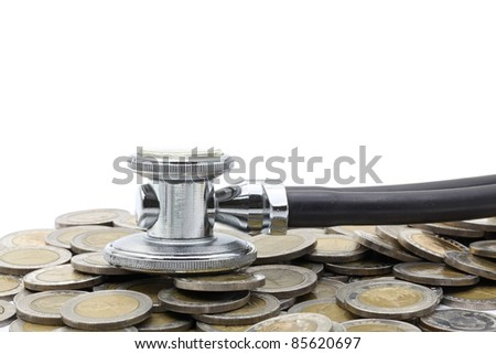 stethoscope on currency coin for financial examination healthy concept