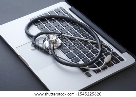 Stethoscope on keyboard laptop computer. Medical Information and technology concept #1545225620