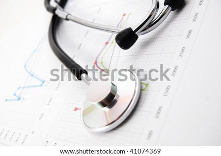 stethoscope on medical data chart in hospital