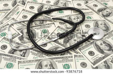 Stethoscope on money background - medical business concept