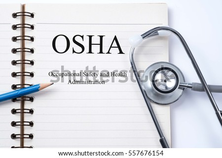Stethoscope on notebook and pencil with Occupational Safety and Health Administration OSHA words as medical concept