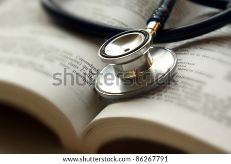 Stethoscope on open book isolated
