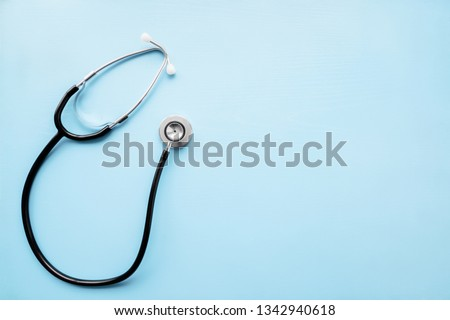 Stethoscope on pastel blue table. Doctor tool for heartbeat and noise of lungs listening. Healthcare concept. Empty place for text, quote, sayings or logo. #1342940618