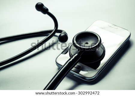 stethoscope on smartphone - checking security on smartphone concept