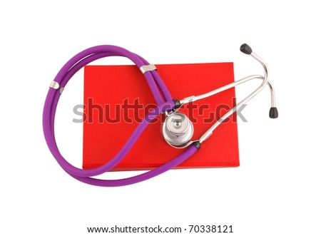 Stethoscope on the red book isolated on white