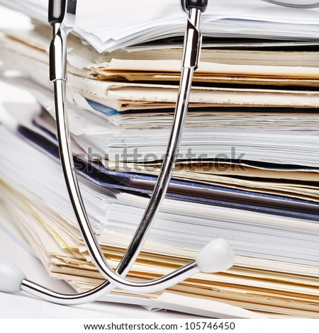 stethoscope on the stack of paper