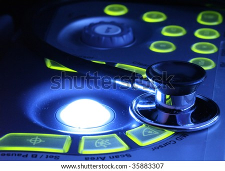 stethoscope on the ultrasound machines control panel