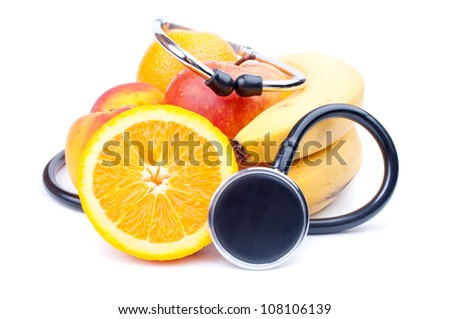 Stethoscope on the various fruits, isolated on white - stock photo