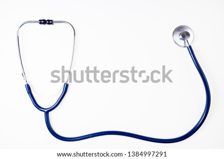 Stethoscope on white background. Doctor equipment. Medical background. Medicine, medical examination, health care concept. Copy space, top view #1384997291