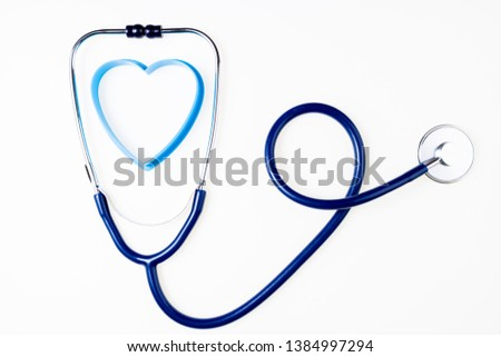 Stethoscope on white background. Doctor equipment. Medical background. Medicine, medical examination, health care and  cardiology concept. Copy space, top view #1384997294