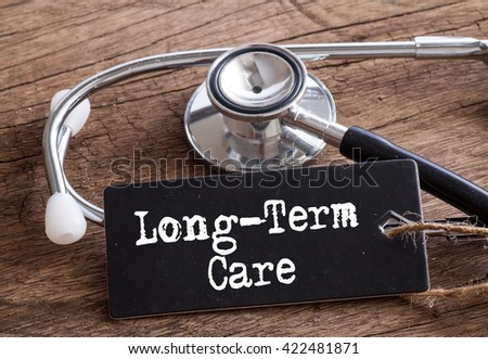Stethoscope on wood with Japanese Long Term Care words as medical concept