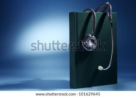 Stethoscope Rest on Textbook - stock photo