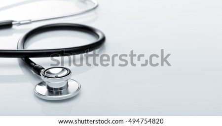 stethoscope. stethoscope with reflection. stethoscope background. stethoscope with reflection on glossy background.