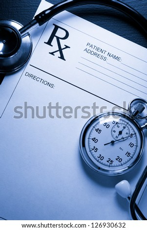 Stethoscope, stopwatch and patient list on black