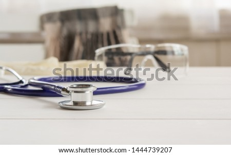 Stethoscope, vital signs headphones on the counter, doctor work and tools