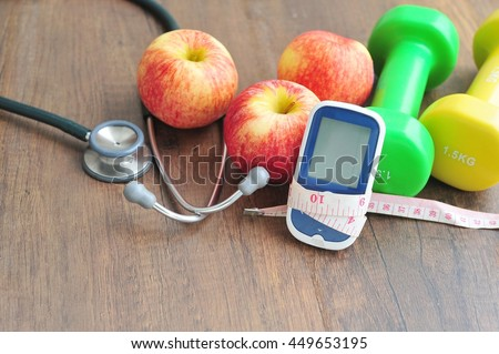 Stethoscope with glucose meter,fruits and dumbbells for using in fitness, concept to control diabetes, Exercise in Diabetes Patients concept. Stock photo ©