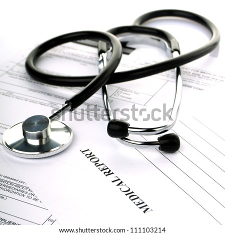 Stethoscope with health insurance on a white background