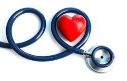 Stethoscope with heart on light background