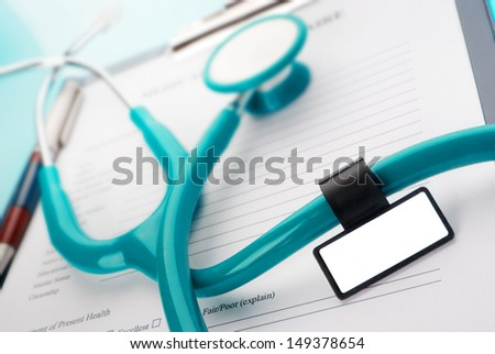 Stethoscope with medical ID tag on medical document (medical questionnaire)