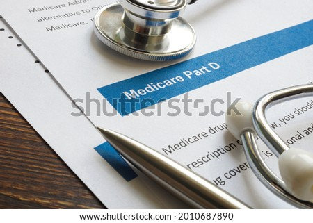 Stethoscope with medicare part D drug coverage info and pen. Photo stock ©