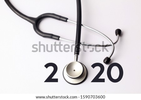 Stethoscope with 2020 number on white background. Happy New Year for healthcare and medical banner/calendar cover. Creative idea for new trend in medicine treatment and diagnosis concept.