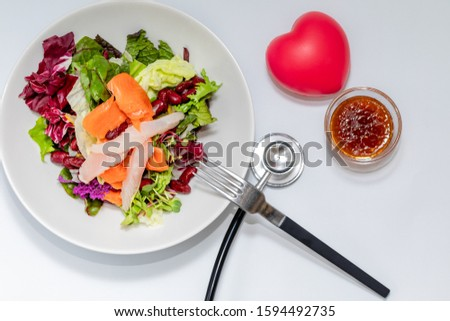 Stethoscope with salad diet to diet