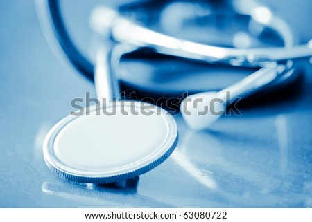stethoscope with shallow depth of field and blue tint