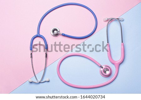 Stethoscopes on color background. Cardiology concept