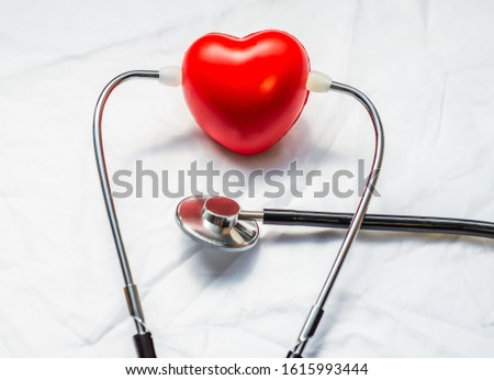stethoscopes with red heart on desk, health check concert.