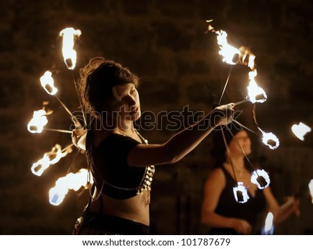 STETTENFELS, GERMANY - APRIL 30: Medieval fire show with fire dancers at the Castle Stettenfels on April 30, 2012 in Stettenfels, Germany.