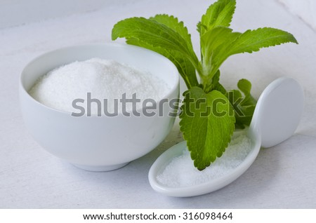 Stevia Powder and Fresh Leaves. Natural sweetener. Selective Focus. Taken in daylight.