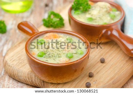 stew with chicken in a creamy sauce portions in a pot horizontal