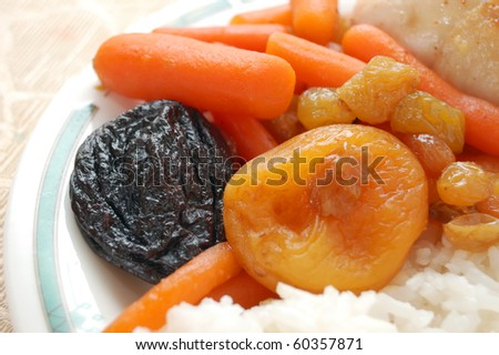 Stewed carrots with rice and chicken - stock photo