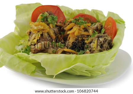 Stewed in sour cream rabbit meat in cabbage leaf