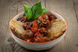 stewed snails with toast and basil france europa