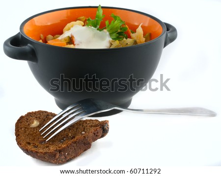 stewed vegetables in a bowl and fork with bread - stock photo