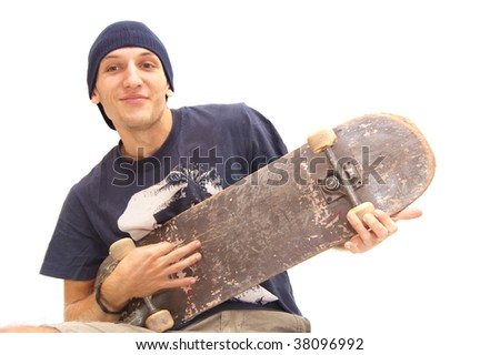 sthis skater holds his skate up like hi is playing a guitar